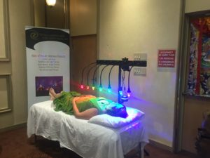 medium of person receiving photon therapy on StellarWaves crystal bed