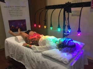 person on StellarWaves crystal bed receiving vibrational healing