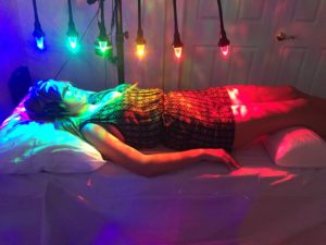 woman under 7 chakras on StellarWaves crystal bed
